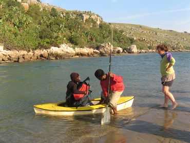 Local ferryman helps hikers cross the Mtentu River